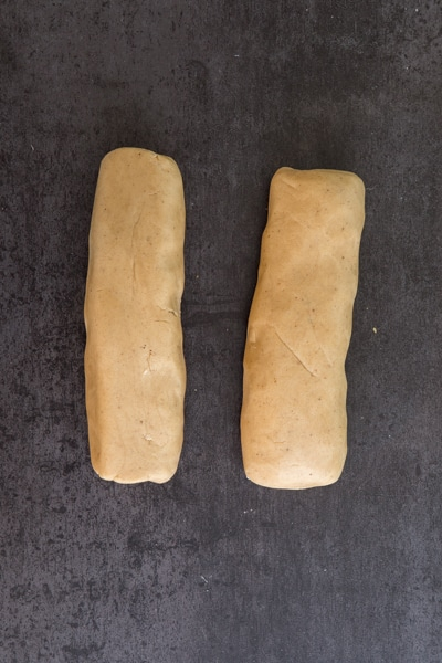 rolling the dough into two logs