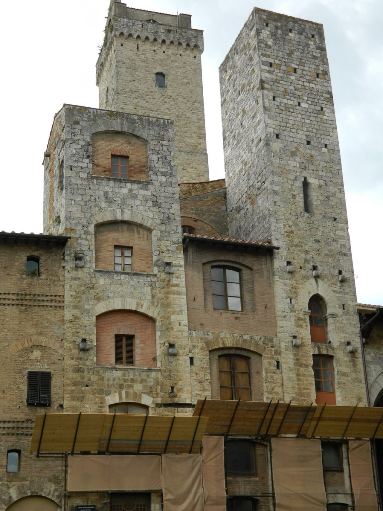 Towers surrounding Piazza Cisterna, San Gimignano, Tuscany.