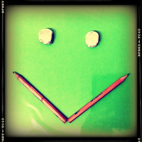 Smile Again: Day 16 Pencils and Erasers on Transparent Plastic Covered Project Board