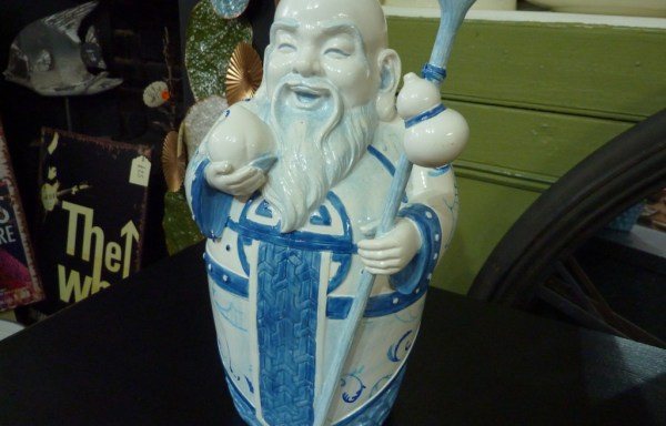 God of fortune with stick ceramic