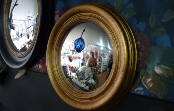 "Large gold convex mirror 13.5"" wide"