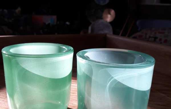 Two green glass candle holders