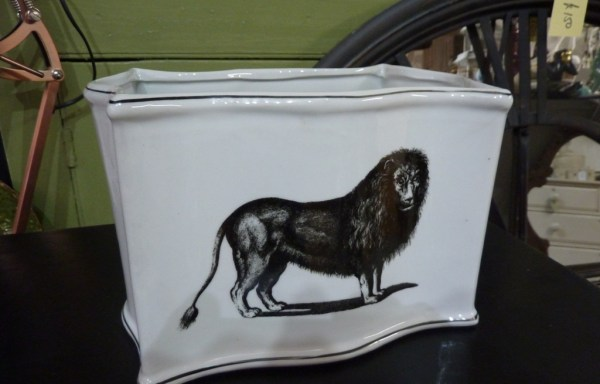 White planter with lion decal