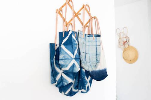indigo tote bags hanging on accordion hangers