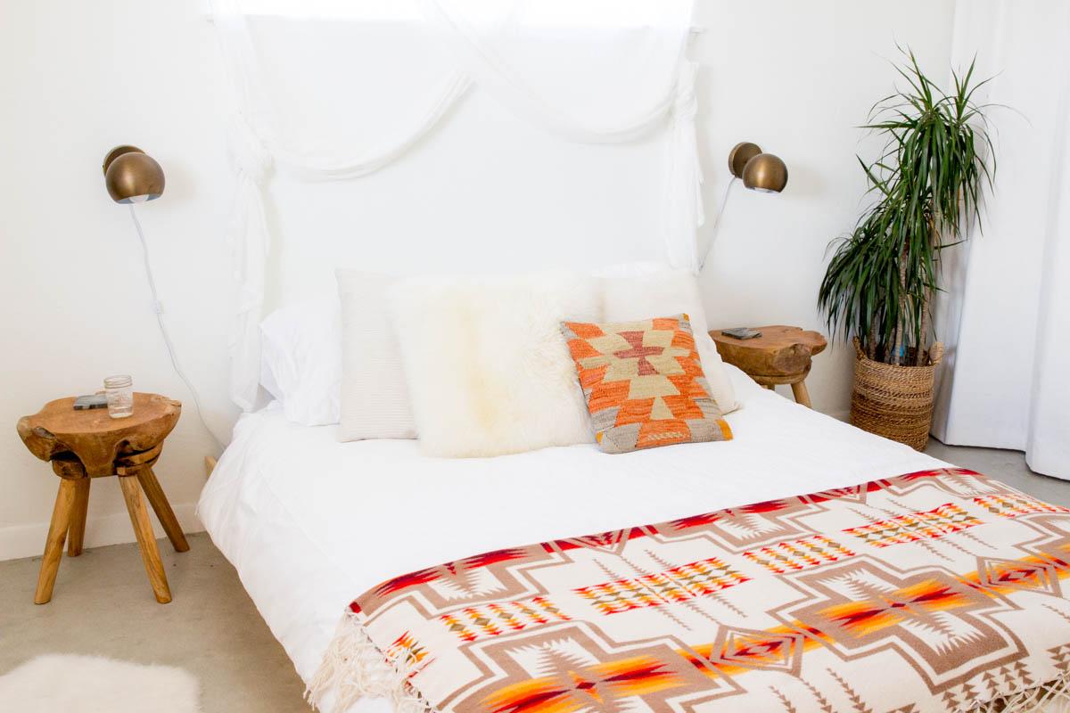 desert inspired orange and red bedroom bronze globe sconce