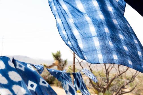 Beautiful indigo fabrics hanging on clothesline drying