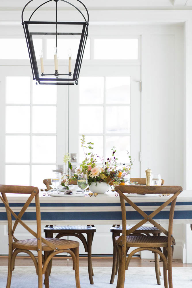 studio mcgee gather french linen stripe table cloth french bistro chairs wood table light pendant