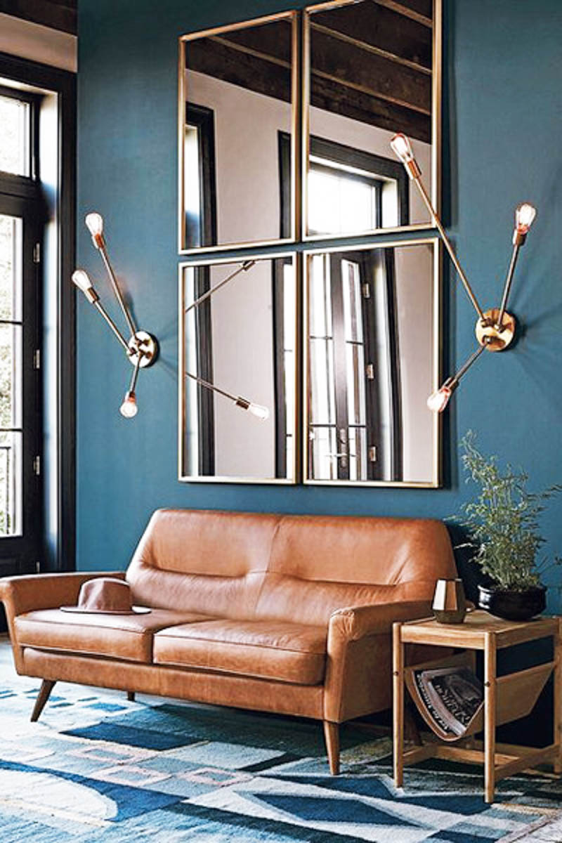 dark walls living room mid century modern design brass lights leather couch