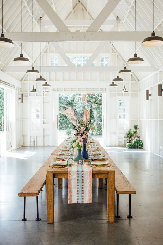 floral converted barn fixer upper style banquet table wedding