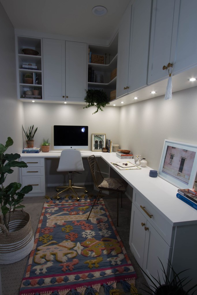 office space white cabinets brass hardware anthropologie rug
