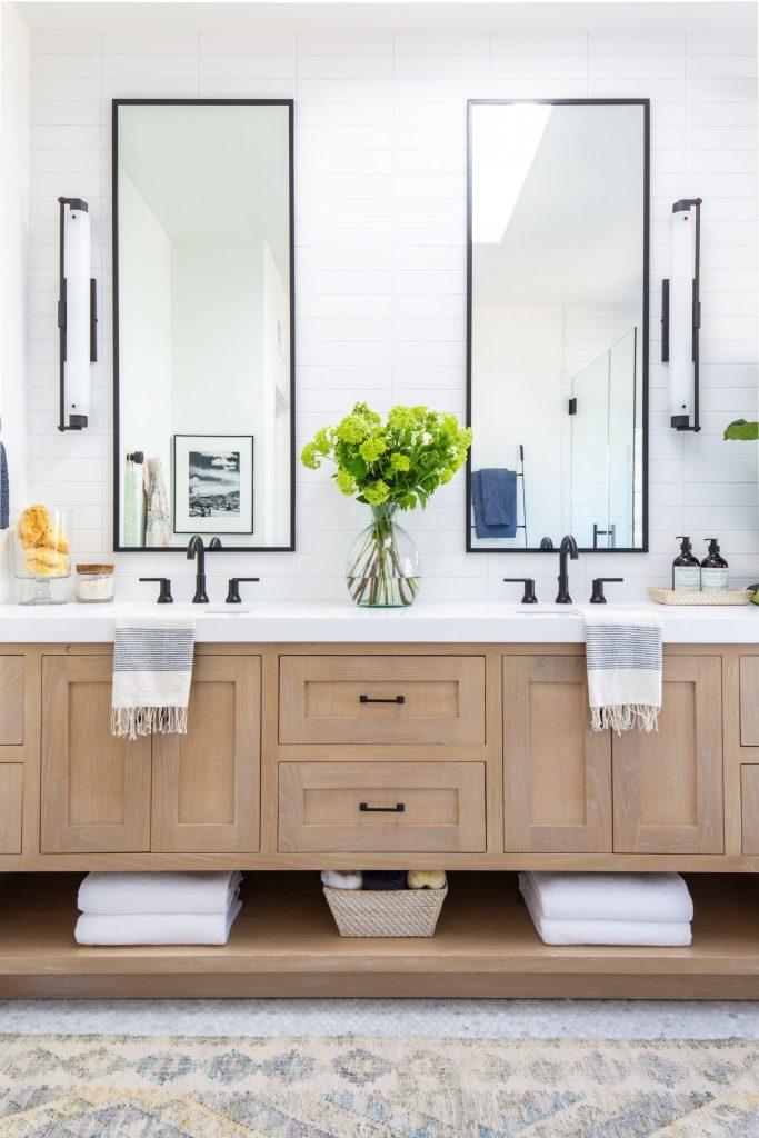 Anita Yokota master bathroom white oak vanity black matte mirrors vintage rug delta faucet