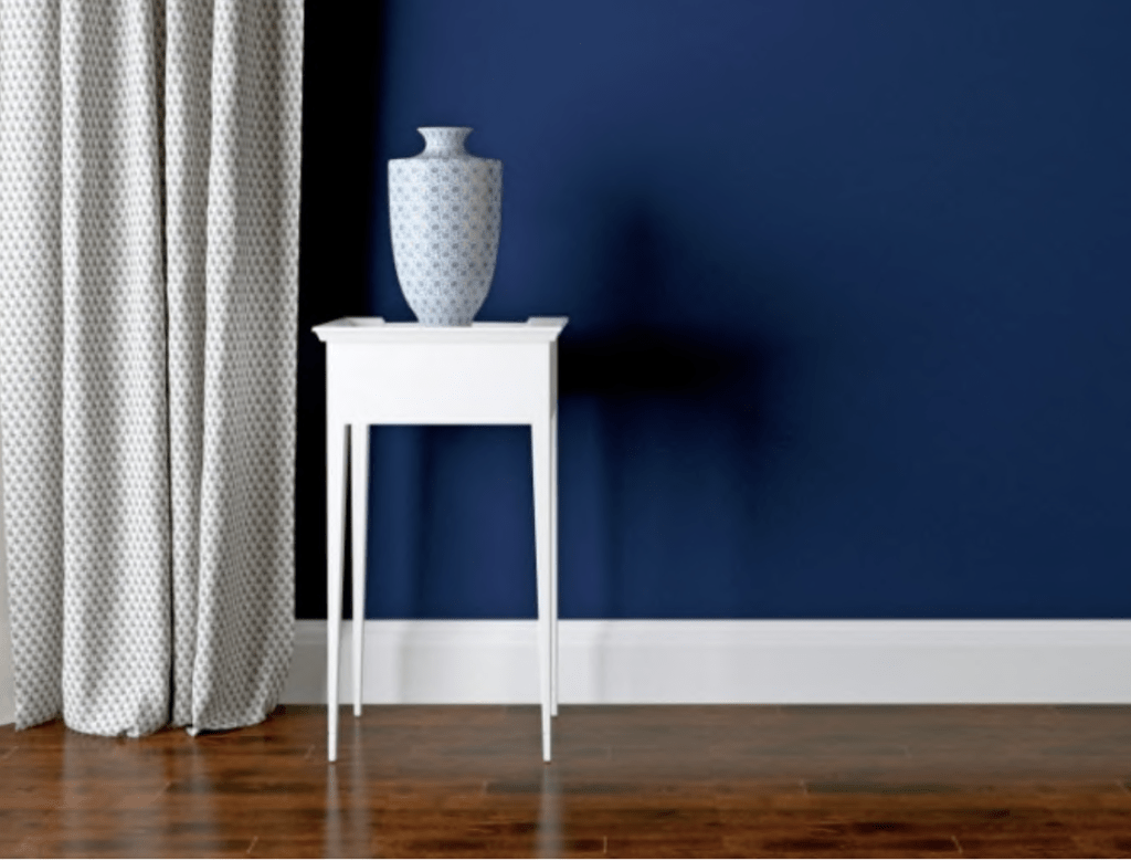 white baseboards navy wall drapery