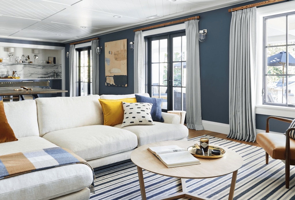media room Emily Henderson living room blue white baseboards