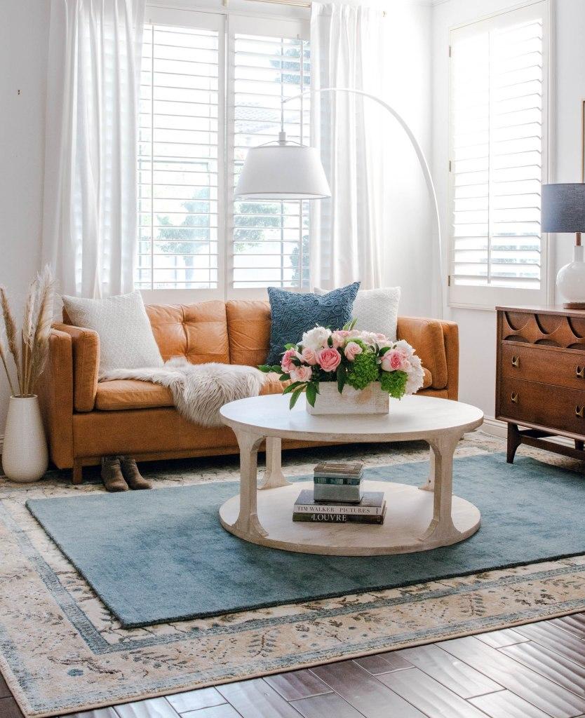 wood floors layered rugs mid century modern credenza