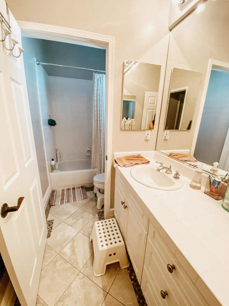 The Desert Den's pre-demo bathroom, single sink with step stool, separate water closet