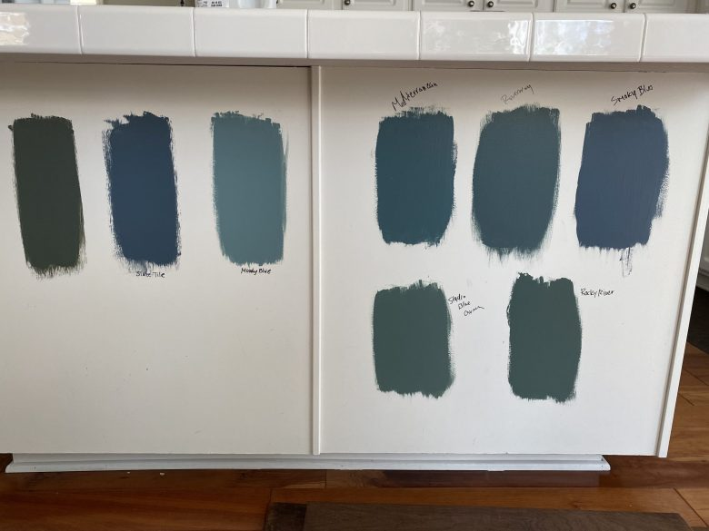 Some of the blue swatches we painted onto the island to decide between