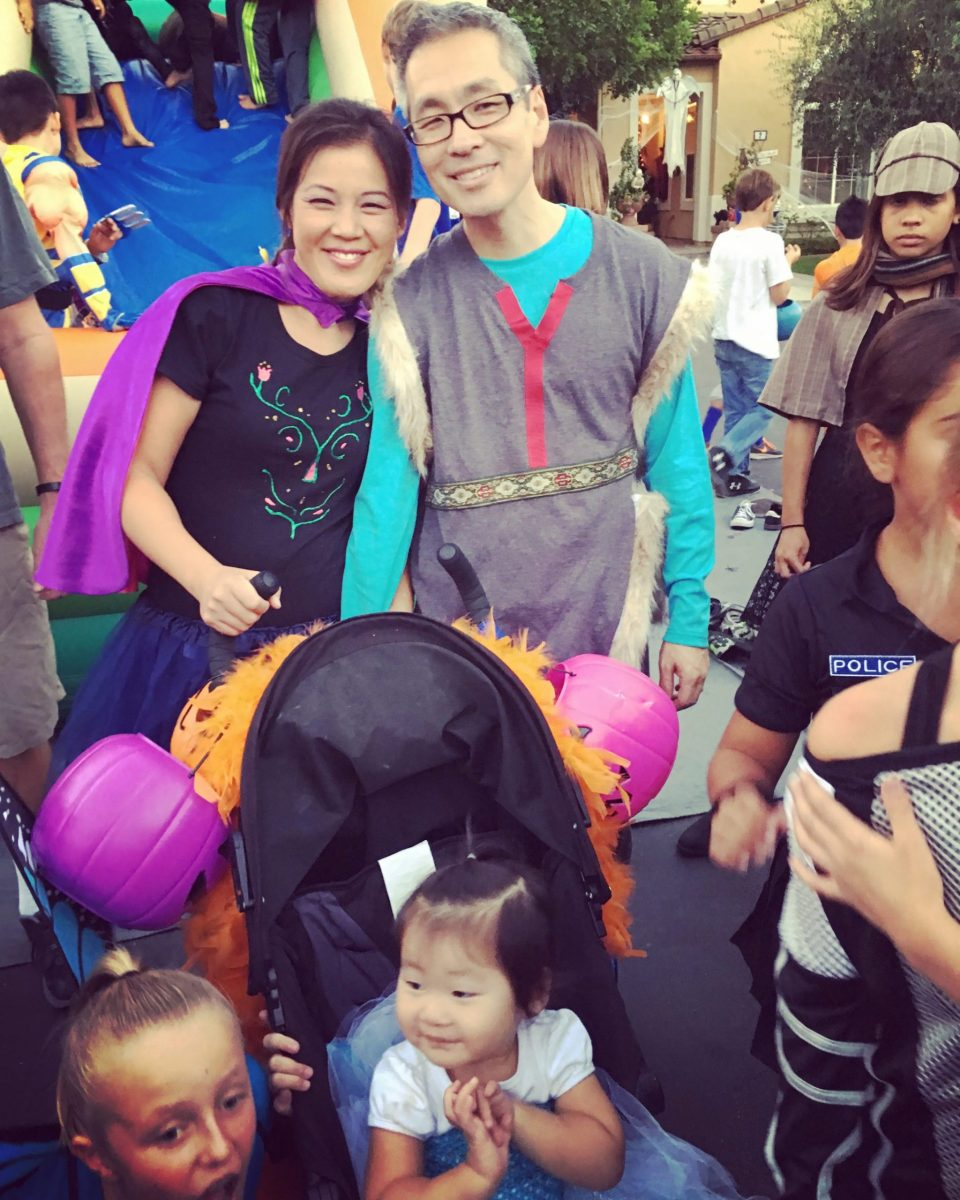 Anita & Travis as Anna & Kristoff with Natalie in a stroller at a past block party
