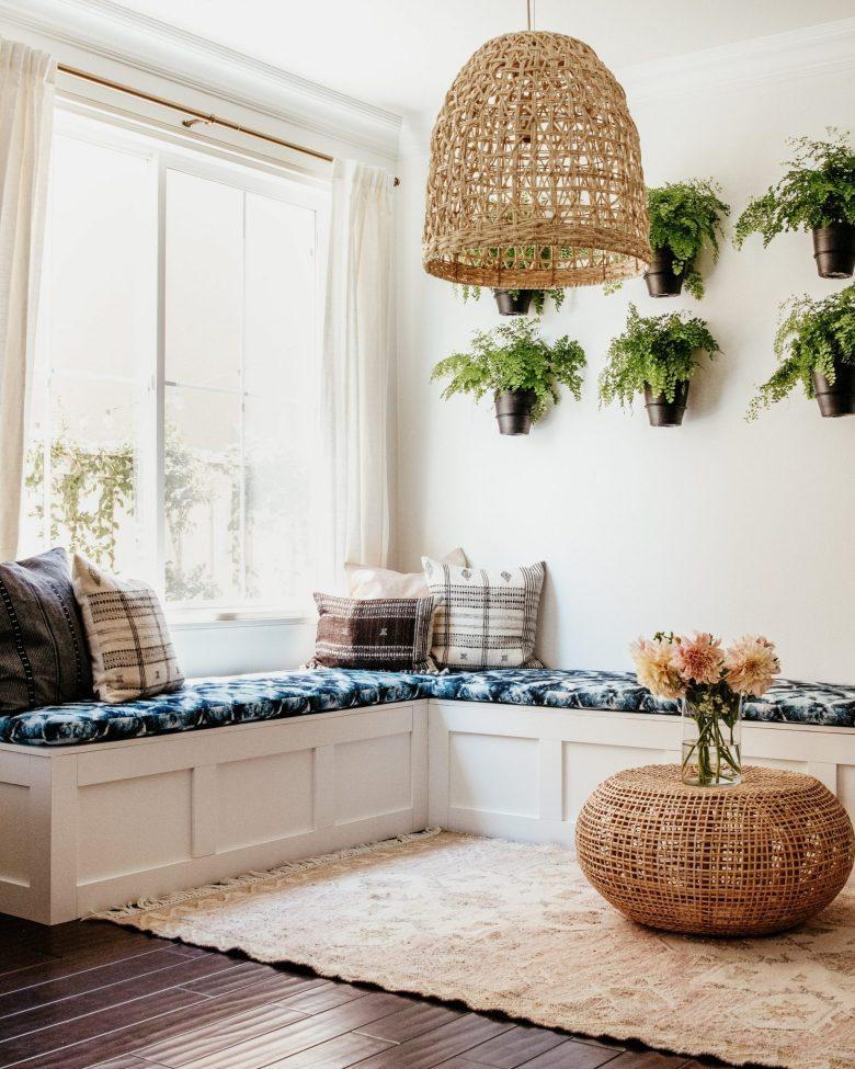 White Shaker Style Bench with blue cushions and wicker details