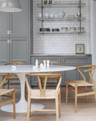 White acrylic Tulip Table featured in grey kitchen