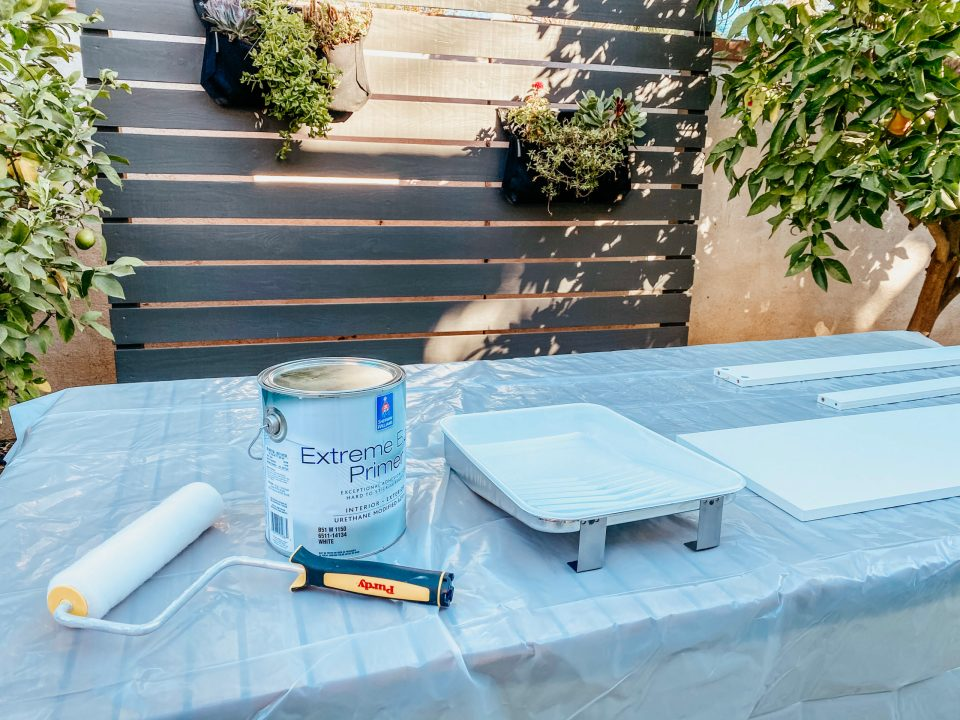 Our work station is all set up outside, with Sherwin-Williams paint and primer