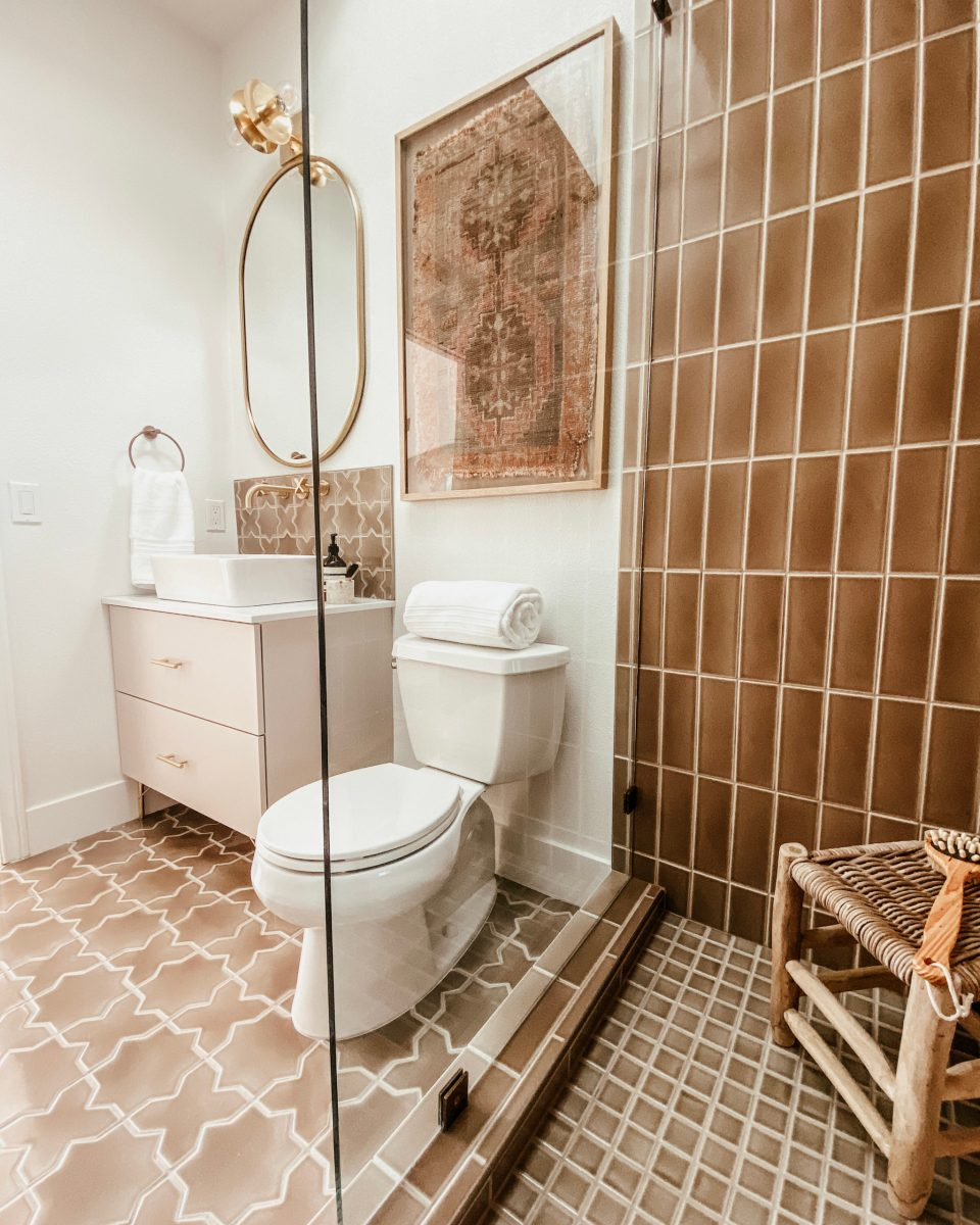 The view of the Desert Bathroom from the corner of the shower, with the stool visible in the corner