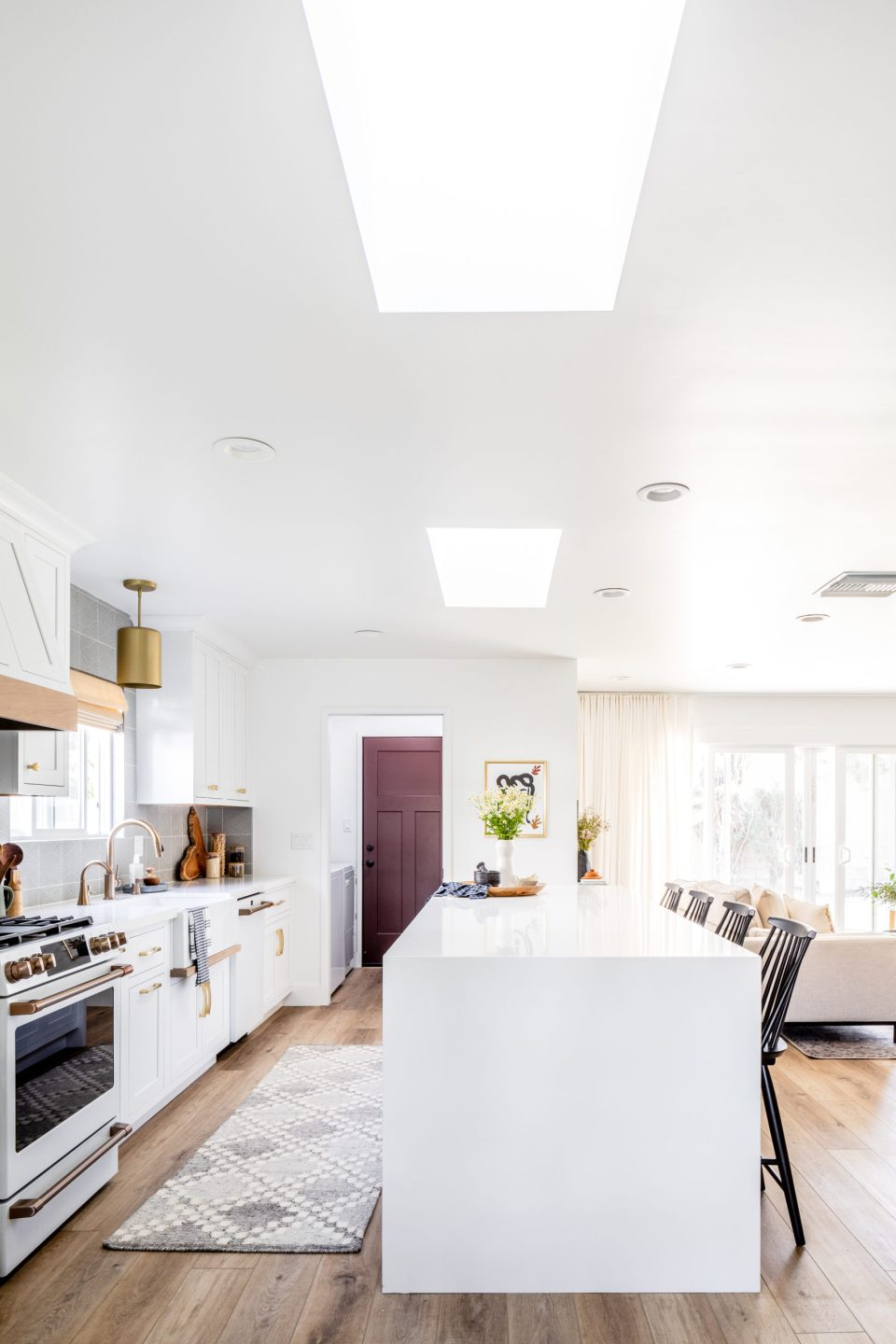 A view into the kitchen, with its sunny skylights and waterfall island