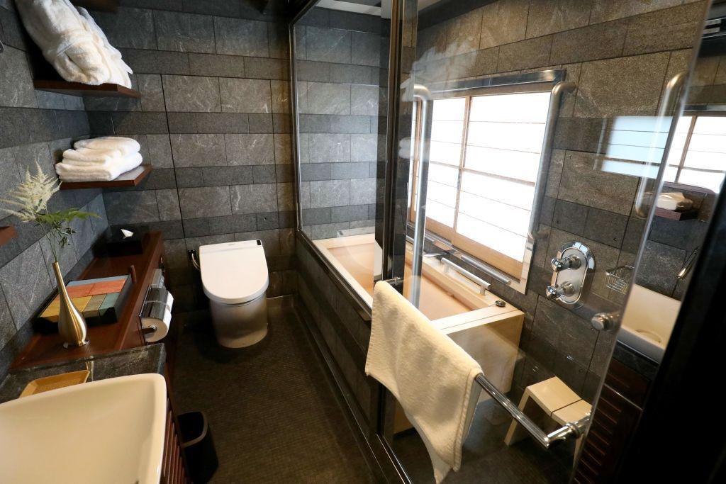 This picture taken on April 26, 2017 shows the bathroom of the Shiki-Shima Suite of the Train Suite Shiki-Shima, operated by East Japan Railway, in Tokyo during a press preview. The luxury sleeper Shiki-Shima, which can accommodate up to 34 passengers, has 10 cars, including a lounge car, a dining car and two observatory cars. The train has only 17 cabins, all suites, and the most expensive room, known as Shiki-Shima Suite, is priced at 950,000 yen (8480 USD) per person when shared by two people.  / AFP PHOTO / JIJI PRESS / str / Japan OUT        (Photo credit should read STR/AFP/Getty Images)