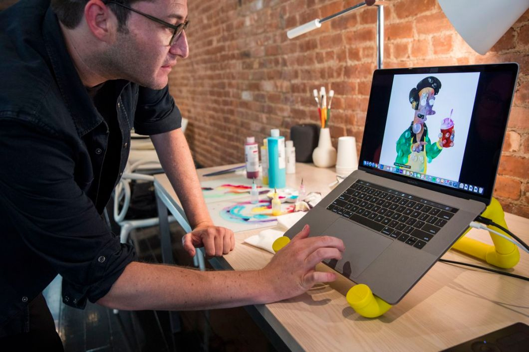 Aaron Axelrod, an LA-based multi-medium artist, used the new MacBook Pro to quickly create Photoshop artwork out of high-res photos of bubbles, including this image of Apu from The Simpsons.