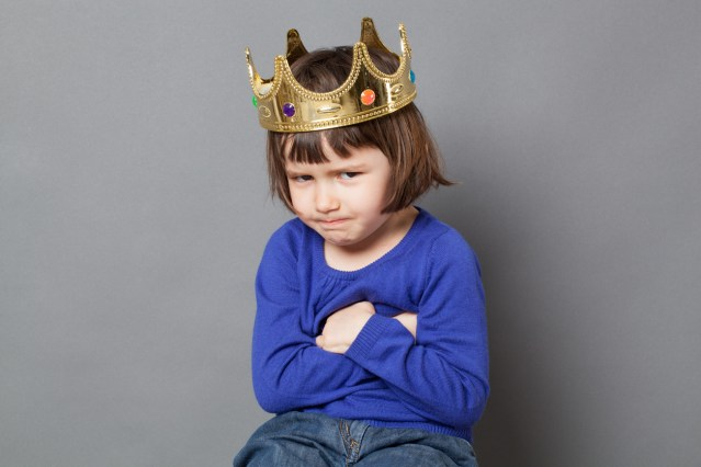 cute preschooler with fun attitude smiling with mollycoddled kid crown