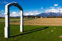 Arch in the valley, Alps in the background