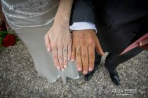 Wedding rings on hands.