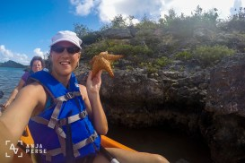Holding a starfish & kayaking in Antigua, Caribbean