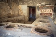 Ancient restaurant with built-in amphoras for the food
