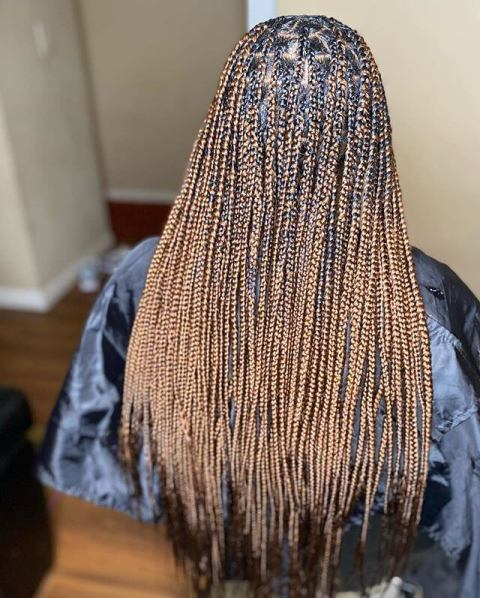 Knotless braids with curly ends