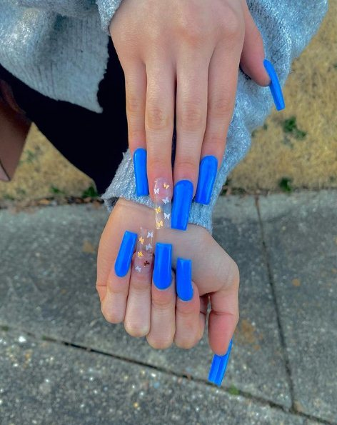 Blue acrylic nails with stickers