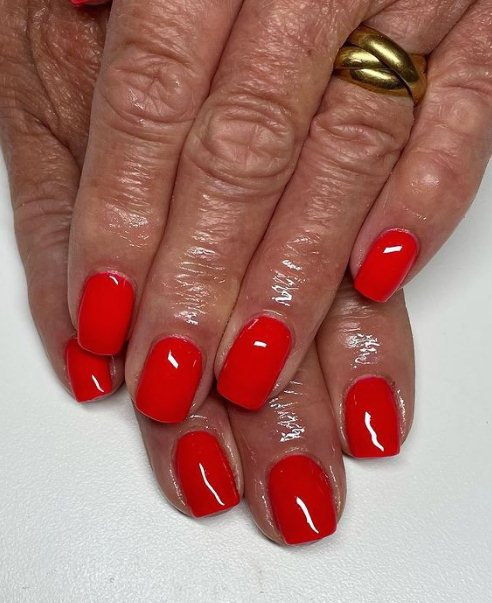 11. Coral Red Red is the color that demands attention, and it's a classic and timeless choice for summer nail designs