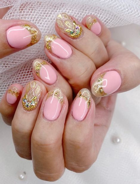 Pink manicure with crystal