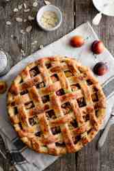 Plum and almond pie with decorative lattice pattern