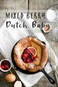 overhead shot of a small skillet with Dutch baby pancake with mixed berries