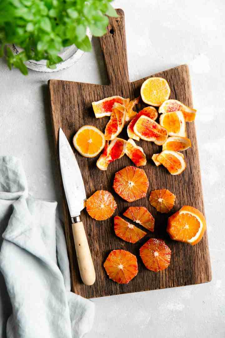 slices of blood orange on a wooden chopping board