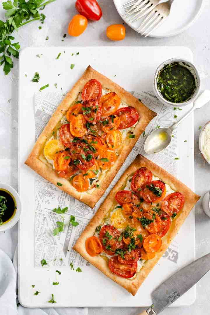 overheads hot of baked mixed tomato and cheese tartlets with parsley dressing on side