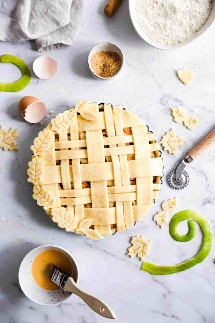 top view of an unbaked apple pie with lattice top