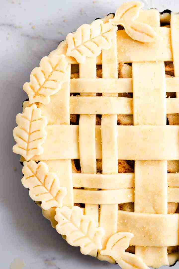 close up of unbaked apple pie and pastry decoration
