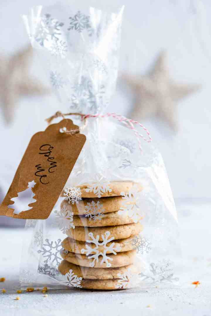 a side sngle shot stack of cookies wrapped in a festive foil