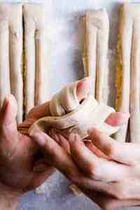 close up of hands shaping the dough