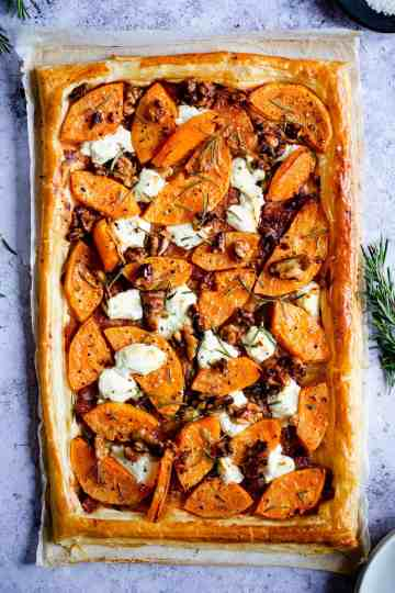 top view of savoury tart with goats' cheese and rosemary