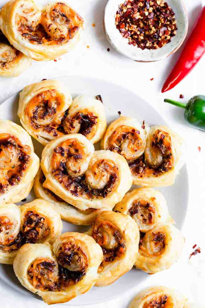 overhead shot of savoury palmiers arranged on a plate