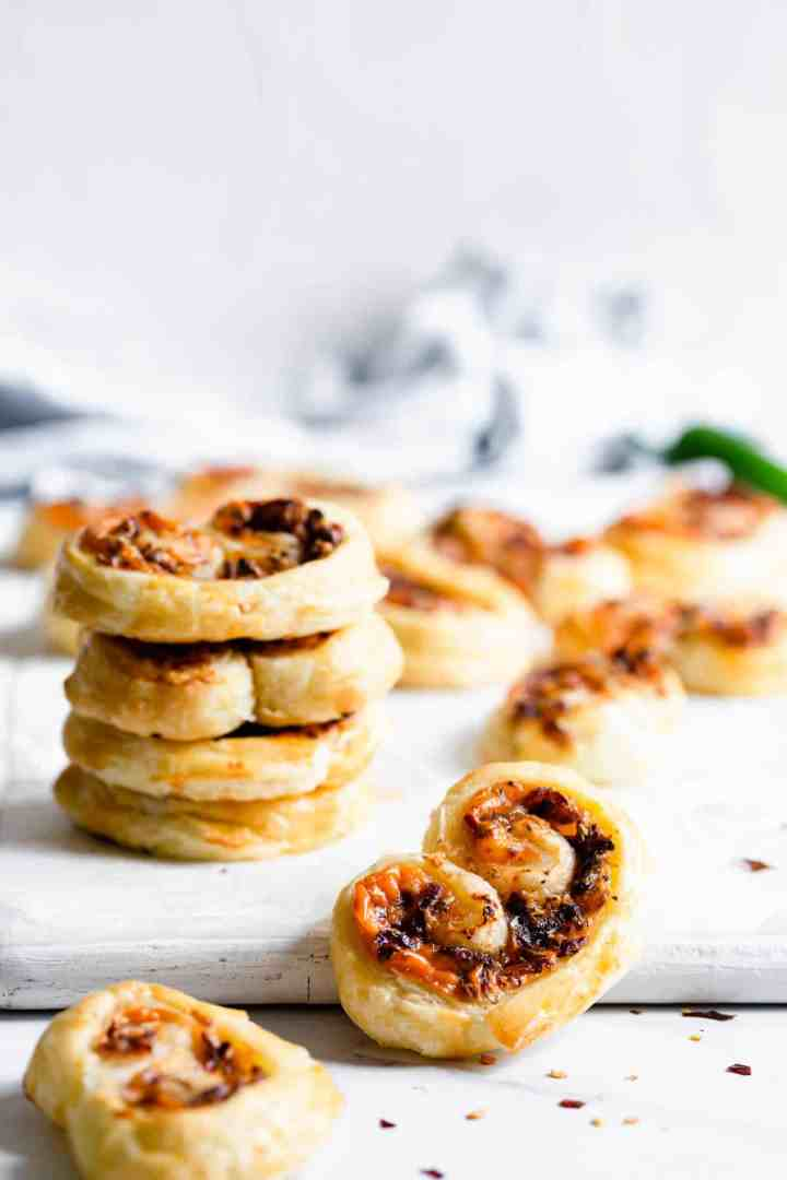 close up at puff pastry palmier filled with cream cheese and caramelised onion