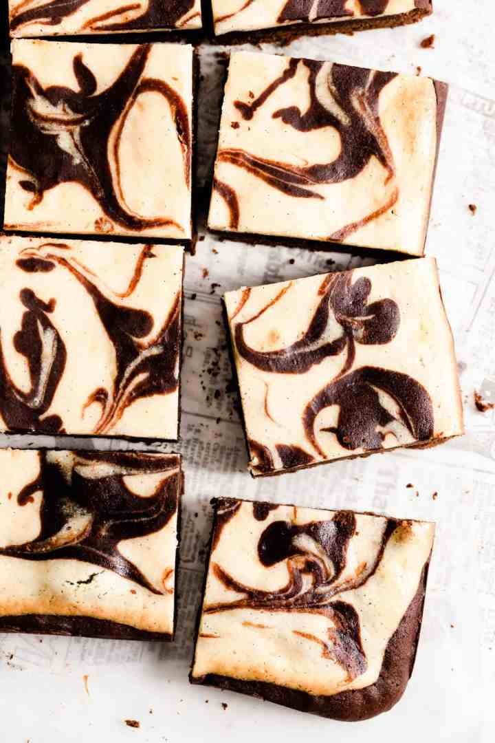 overhead close up of sliced brownies with chocolate swirls on top