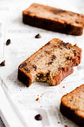 side close up of a slice of banana loaf with bite taken out